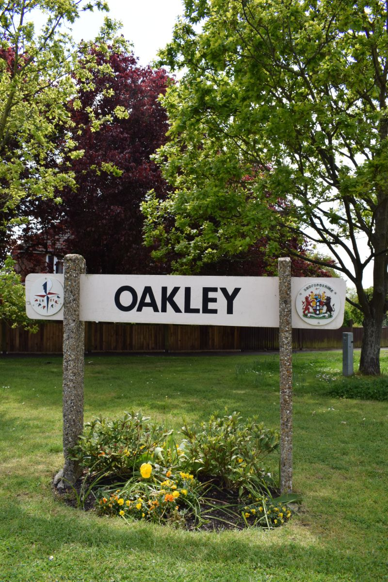Oakley sign post Station Road / High Street